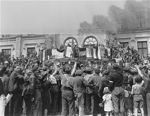 """Displaced Persons"" (DPs) Take Part in a Flag Ceremony (1945)"