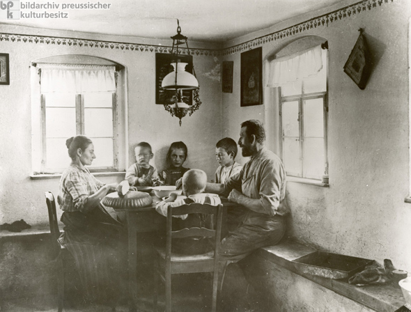A Peasant Family at Lunch (1912)