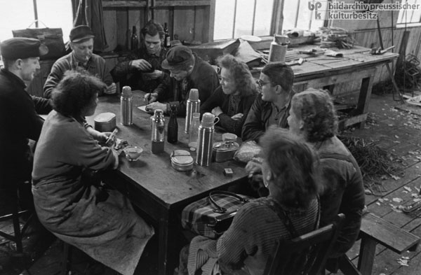 "Members of a ""Socialist Work Collective"" Eat Lunch in the Barracks of a Potsdam Construction Site (1959)"