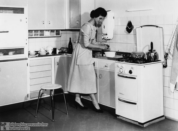 A Housewife in Her New Modern Kitchen (1957)
