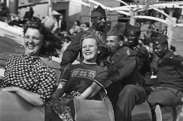 German <I>Fräuleins</i> [Young Ladies] and American Soldiers on a Rollercoaster (1945)