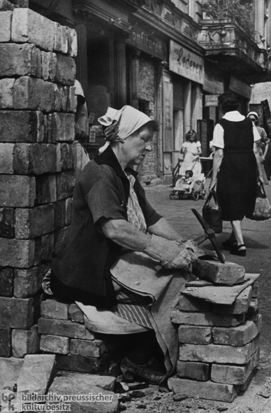 "Putting Every Brick to Use: ""Rubble Woman"" Removing Mortar Remnants (1946)"