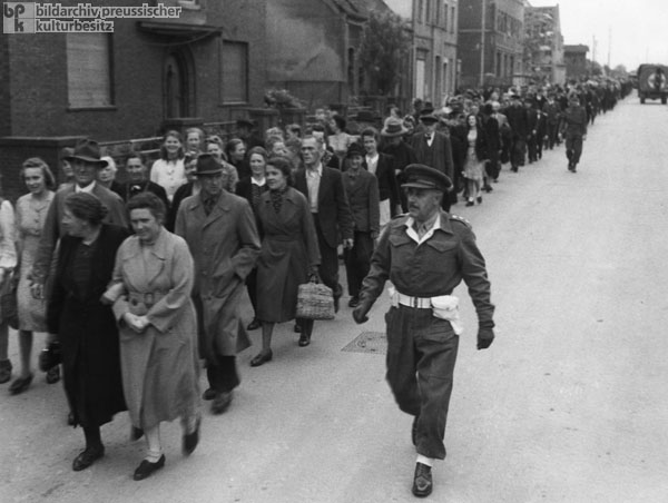 The Population of Burgsteinfurt is Escorted to a Film about the Bergen-Belsen and Buchenwald Concentration Camps (May 30, 1945)