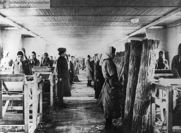 Roma and Sinti Women Weave Reed Mats in the Ravensbrück Concentration Camp (1941)