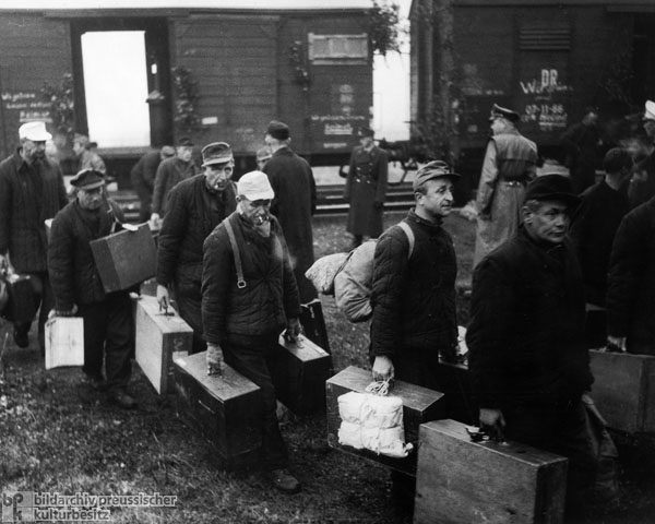 POWs Returning from the Soviet Union Exit Freight Cars after arriving at the Train Station on the Border in Herleshausen (Hesse) (October 1, 1955)