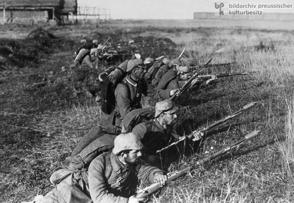 German Infantrymen on the Frontline with Weapons at the Ready (1914)