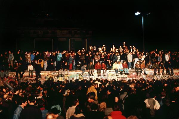 Opening of the Berlin Wall: Cheering Berliners on the Wall at Brandenburg Gate (November 9, 1989)