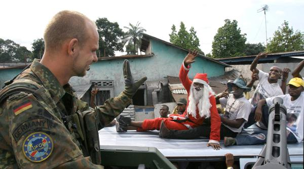 Bundeswehr Paratrooper Waves to Kinshasa Residents during a Patrol of the City (October 26, 2006)