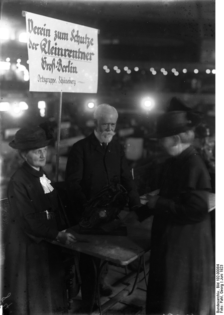Economically Distressed Middle-Class Pensioners Sell Family Heirlooms at an Exhbition in the <I>Sportpalast</i> in Berlin (1923)