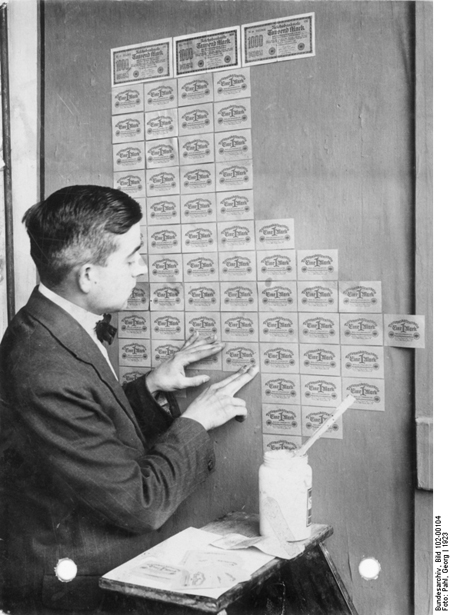 Wallpapering with Worthless Banknotes (1923)