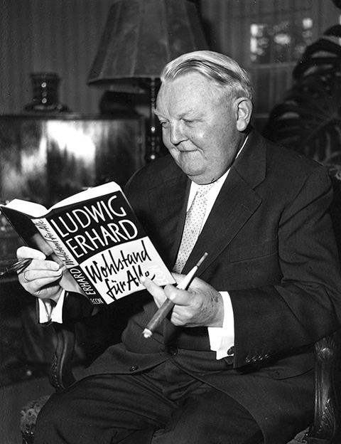 Ludwig Erhard with his book <I>Prosperity for All</i> (January 28, 1957)