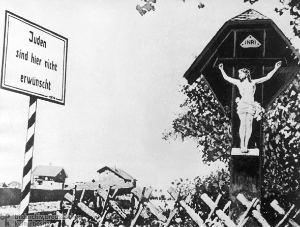 A Crucifix and an Anti-Semitic Message at the Entrance to a Franconian Village (1935)