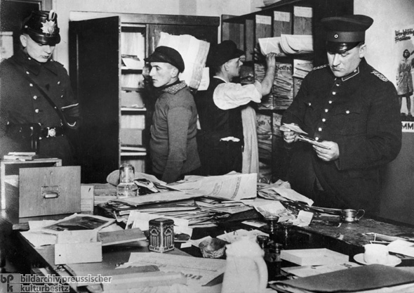 Members of the Gestapo and the Security Police [<i>Schutzpolizei</i>] Occupy and Search the Berlin Headquarters of the German Communist Party (February 23, 1933)