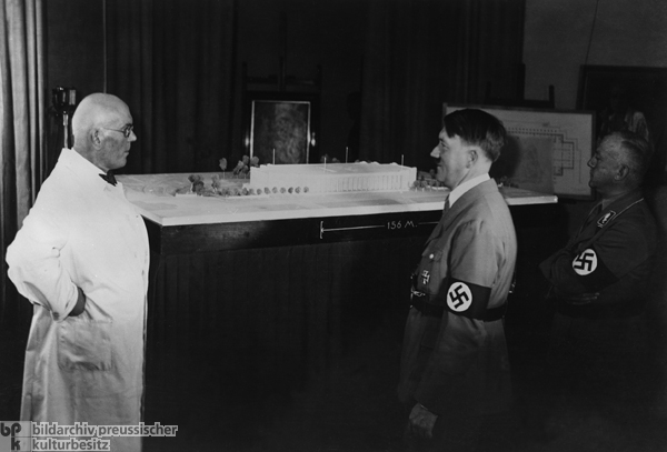The Architect Paul Ludwig Troost with Hitler and Gauleiter Adolf Wagner before a Model of the House of German Art (1933)