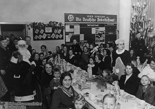 Christmas Celebration at Mercedes-Benz, with German Labor Front Bulletin Board in the Background (1938)