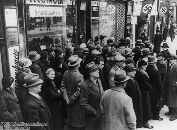 Germans in Front of a Radio Store in Berlin Listen to News of the Invasion of Poland (September 1, 1939)