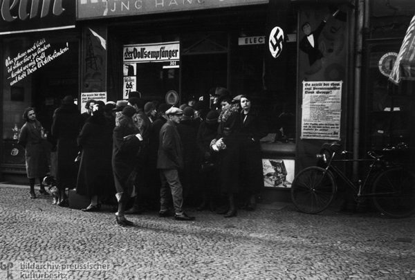 Passersby in Front of a Berlin Radio Store Listen to the Official Radio Broadcast of a Speech by Hitler (1936)