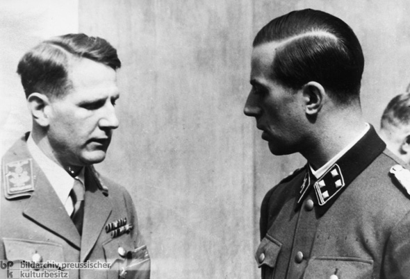 Reich Minister of Health Dr. Leonardo Conti Speaks with Hitler's Personal Physician, Dr. Karl Brandt (August 1942)