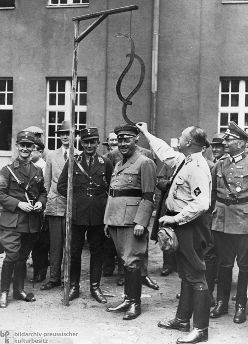 The End of the Constitutional State: Prussian Minister of Justice Hanns Kerrl Watches as the § Symbol (Traditionally Used to Denote German Legal Articles) is Hung from the Gallows (1934)