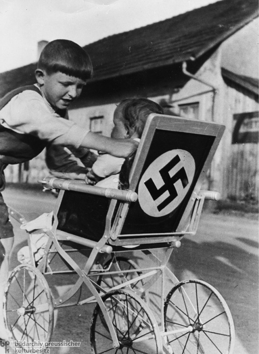 Stroller with a Swastika Painted on its Back (1937)