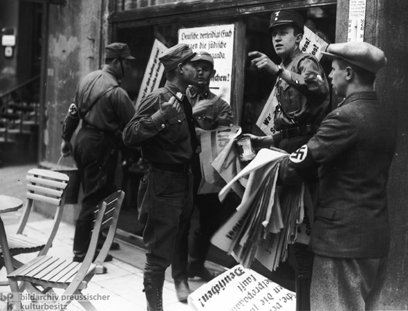 SA Members Hang Boycott Posters on a Jewish Shop in Munich (April 1, 1933)