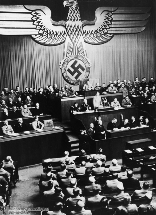 Adolf Hitler at the Lectern in the Kroll Opera House on the Occasion of the Extension of the