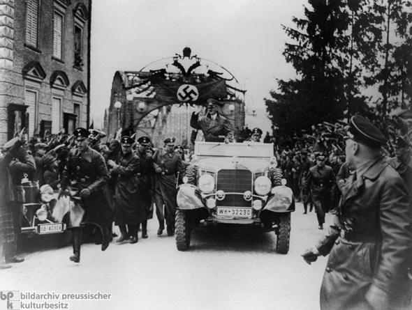 Cheering Austrians Greet Adolf Hitler in his Hometown of Braunau am Inn (March 12, 1938)