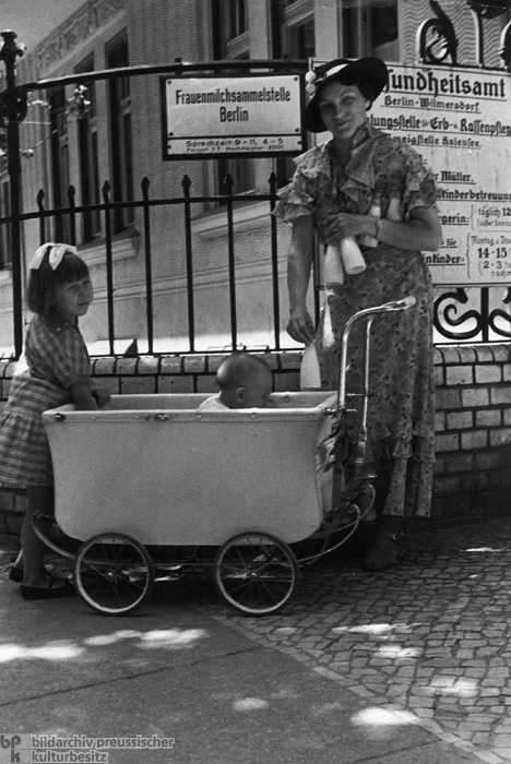 Woman with Two Children in Front of the Breast Milk Collection Site of the Health Office in Berlin-Wilmersdorf (1936)