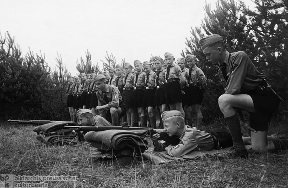 Members of the Hamburg <i>Jungvolk</i> are Instructed in the Use of Carbine Rifles at a Hitler Youth Camp on the Baltic Sea (1938)